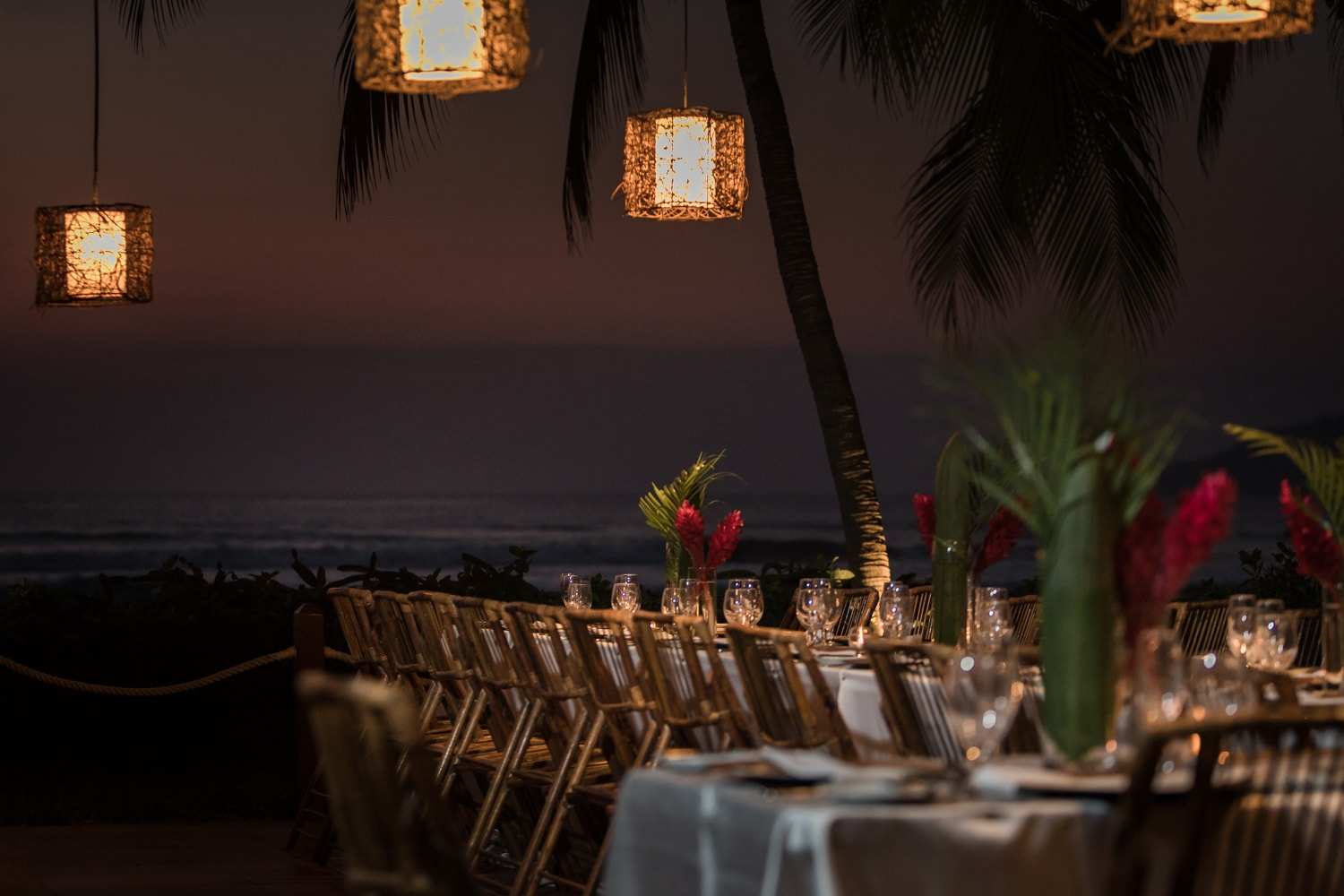Photo of table for wedding reception with ocean views.