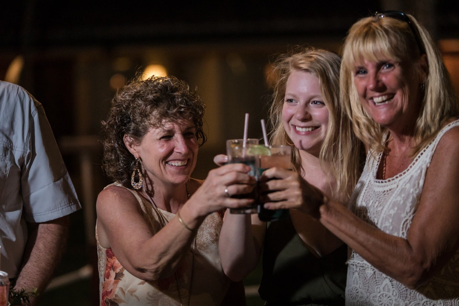 Bride's mother and relatives have a toast during wedding reception.