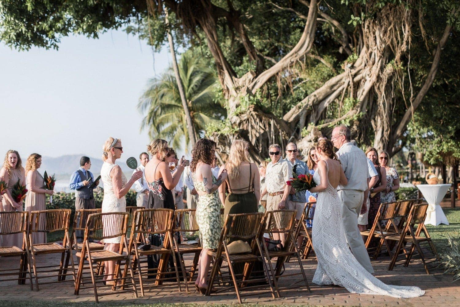 Father walks bride to altar at wedding venue in Costa Rica.