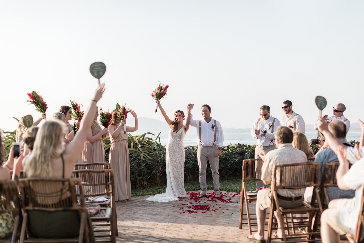 Everyone is celebrating after the bride and groom get married at Tamarindo Diria Resort.