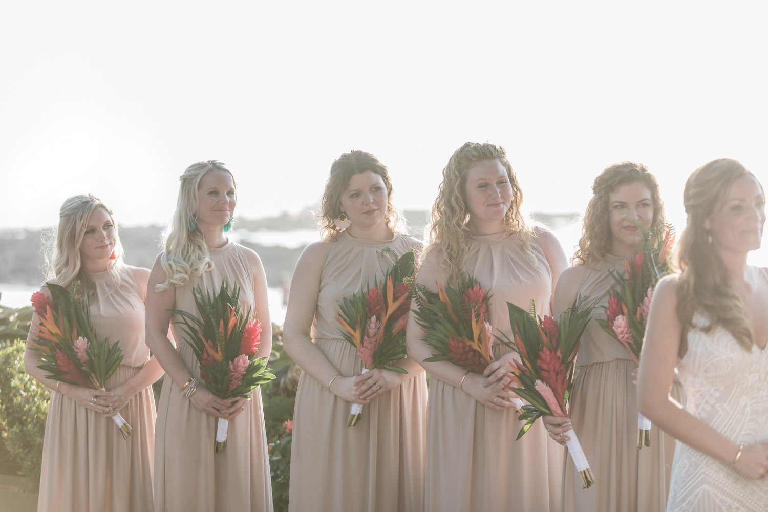 Bridesmaids watch as bride ties the knot in Costa Rica.