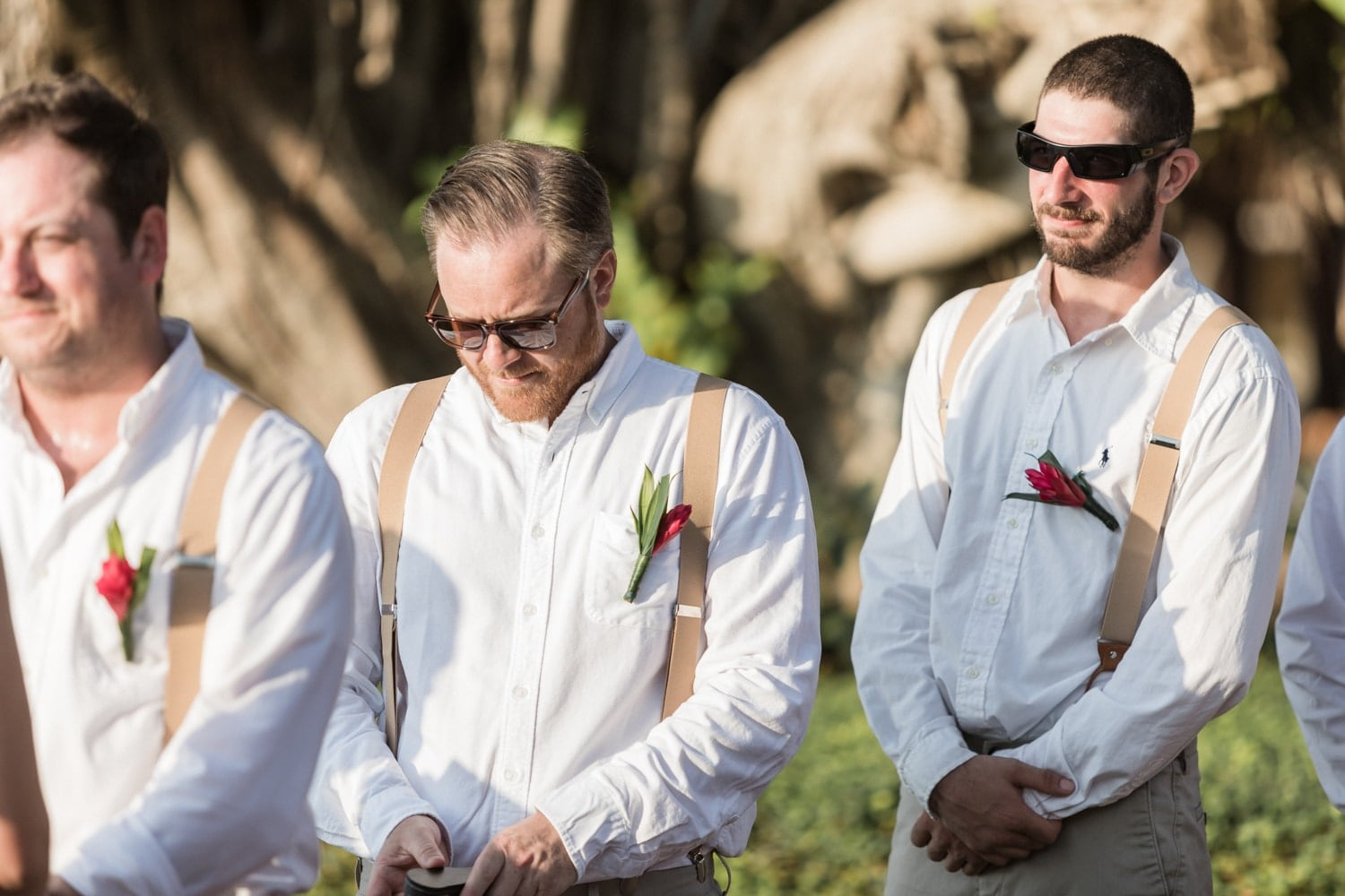 Picture of groomsmen during wedding ceremony at Tamarindo Diria Hotel.