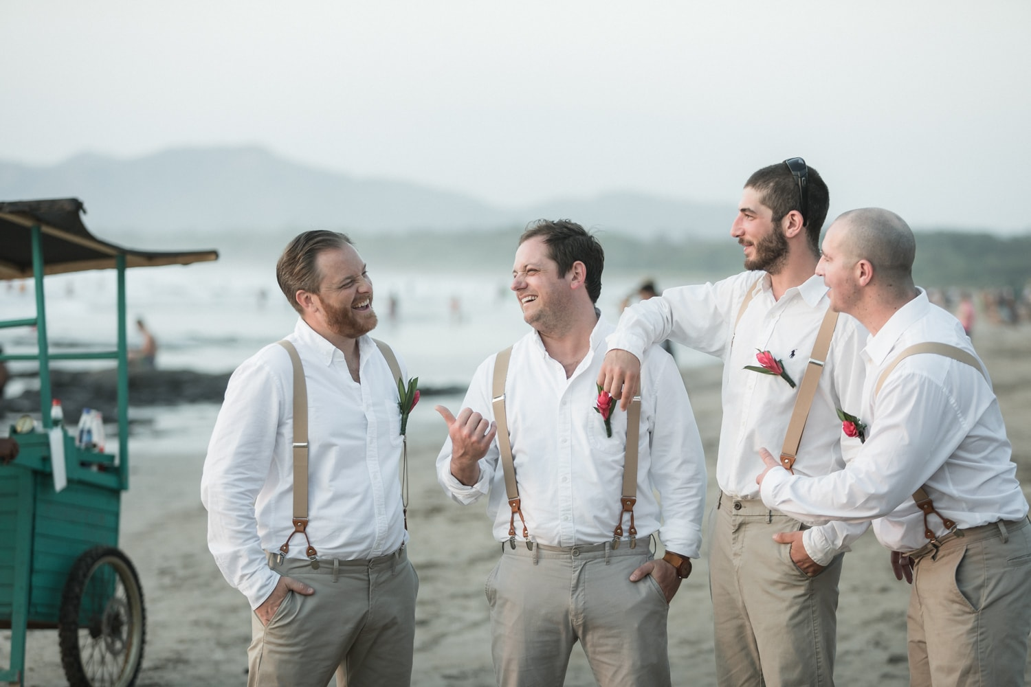 Groom and groomsmen on Tamarindo beach for wedding photos.