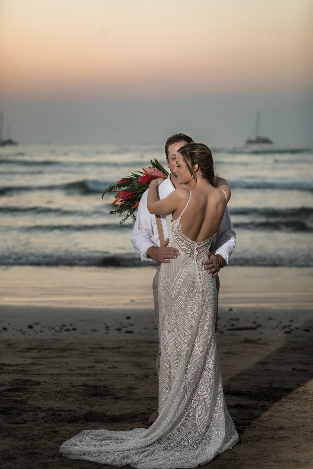 Gorgeous photo of bride and groom on Tamarindo beach at sunset.