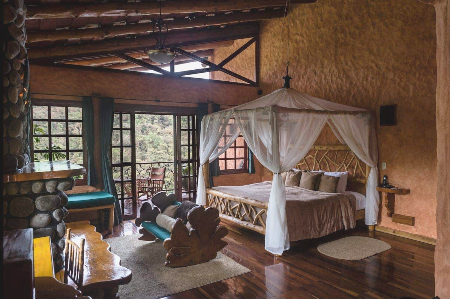 This rustic honeymoon suite at Peace Lodge in Poas overlooks a cloud forest and the Poas Volcano.