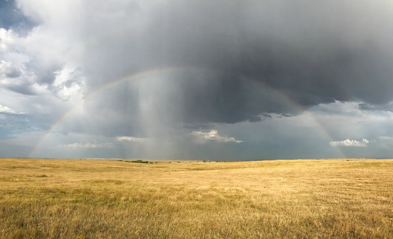 A double rainbow formed after the thunderstorm passed. This iPhone panoramic photo unforuntately does the scene no justice.