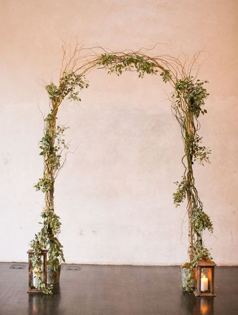 Archway Sticks Lanterns Rustic Wedding.jpg