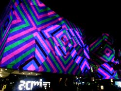 ACMI lights up along Flinders Street.