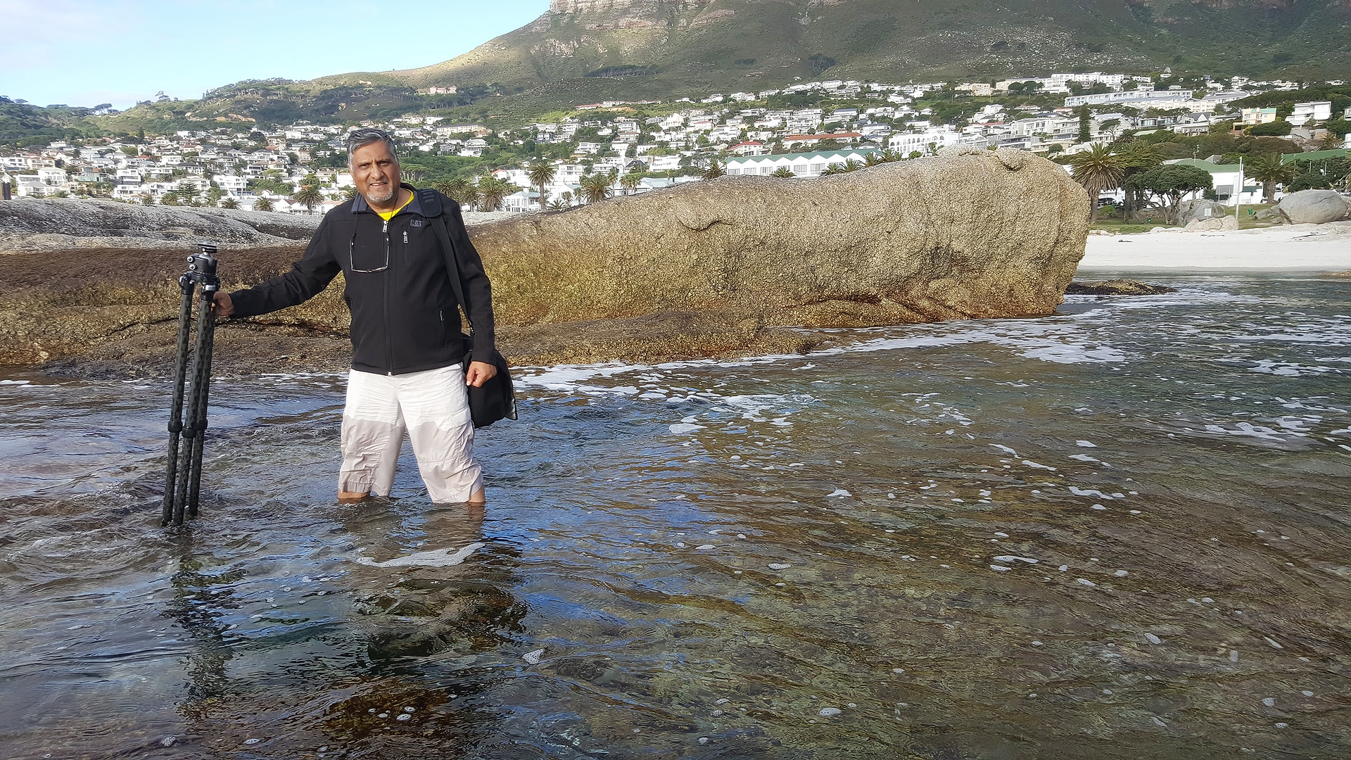 Braving the cold Atlantic Ocean waters at Camps Bay in Cape Town to reach a better vantage point for a shot.