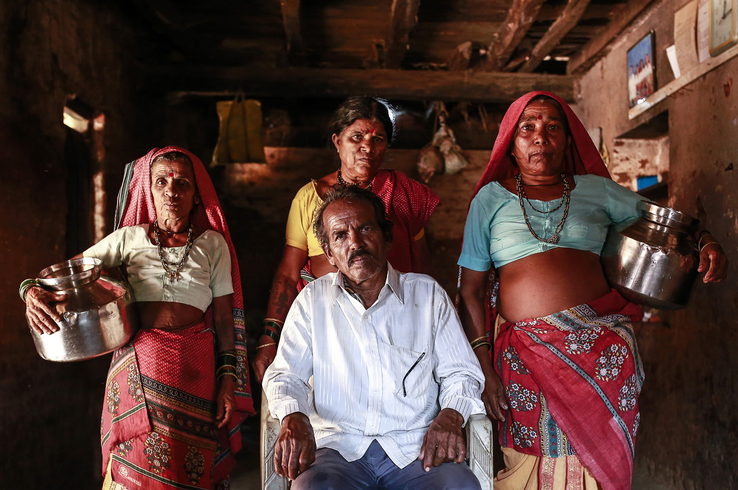 Sakharam Bhagat poses with his wives, Sakhri, Tuki and Bhaagi (L to R) inside their house.