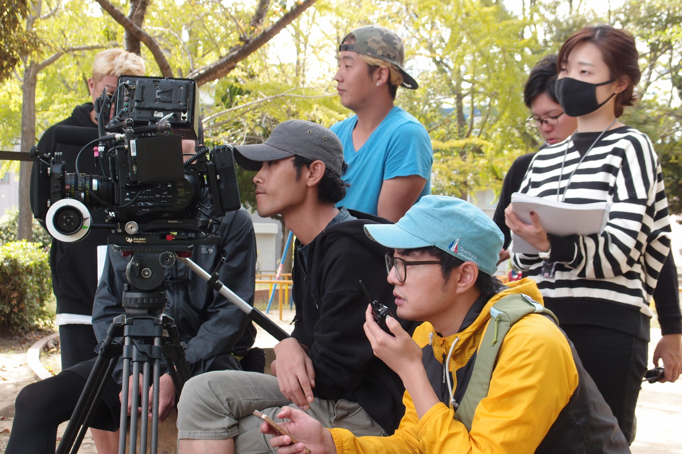 Korean and Japanese film crew working together.