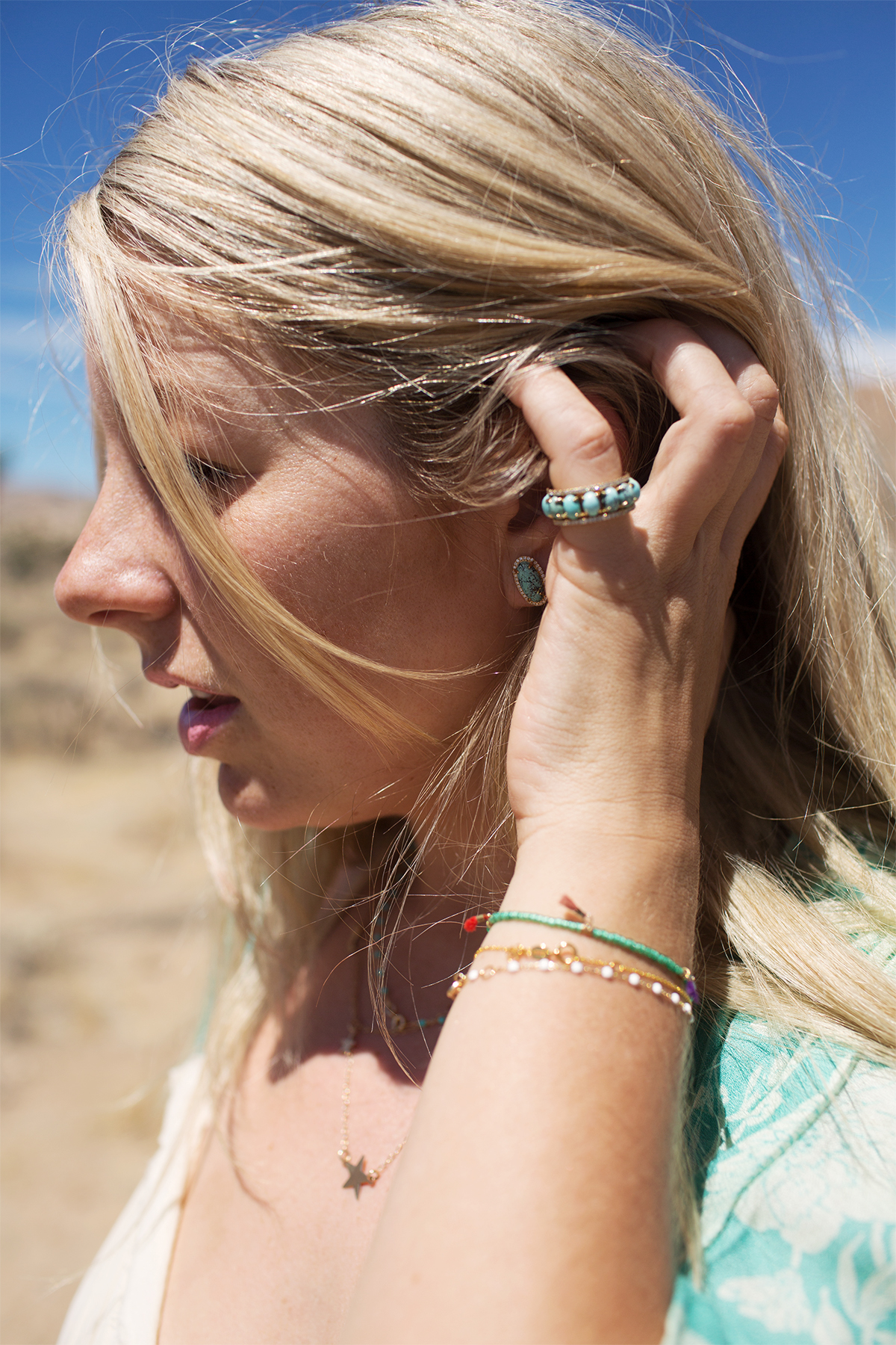 Lola Berry wearing our Pacific Moons earring and ring.