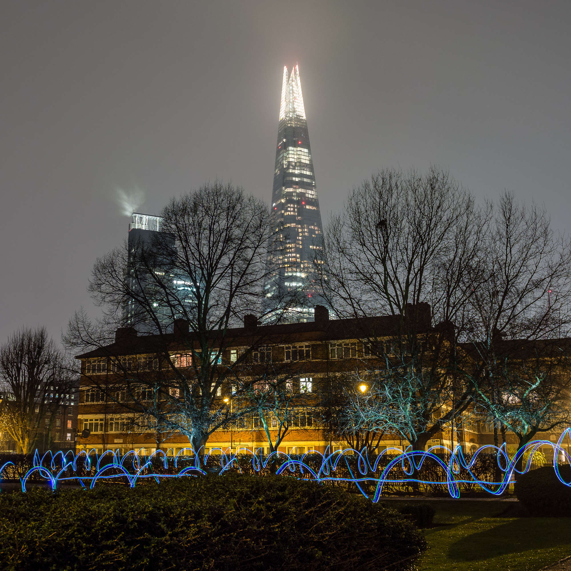 Light-painted trees and LED trails under the Shard