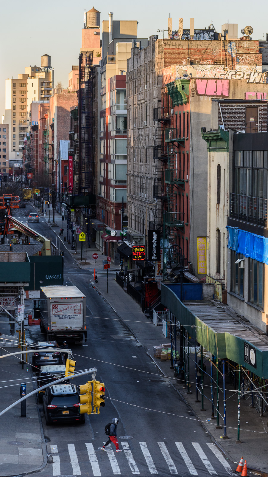 Ludlow St, NYC, dawn, looking across Delancey St