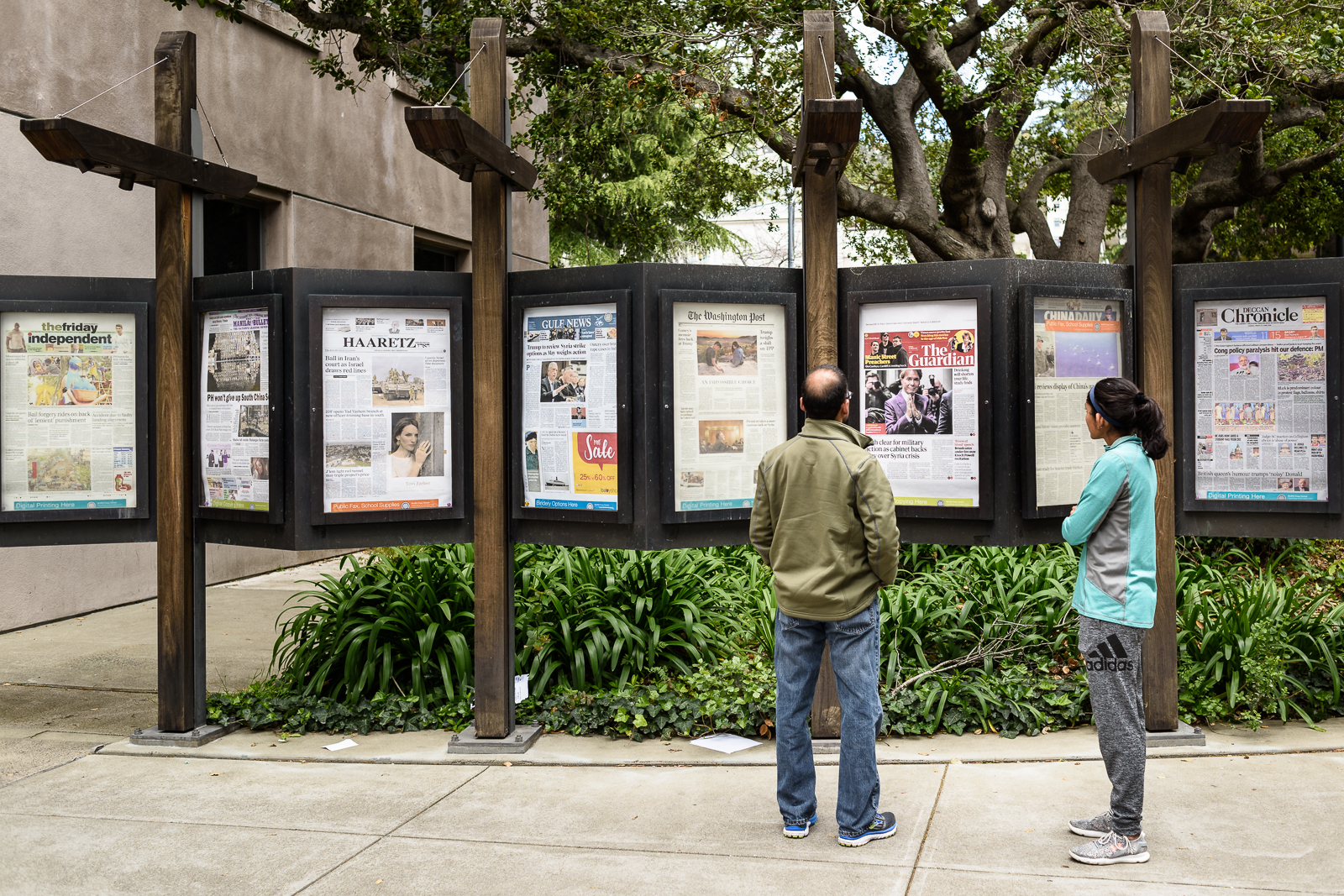 Newspaper front pages from around the world, displayed on the Berkeley Campus