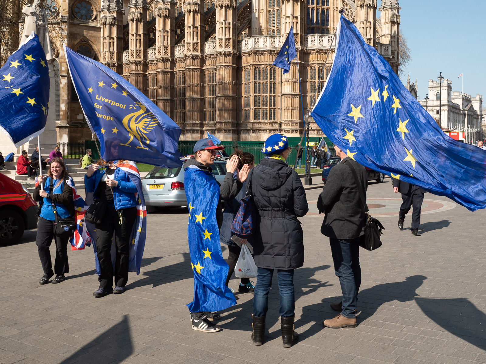 Anti-Brexit protestors with (and wrapped in) EU flags