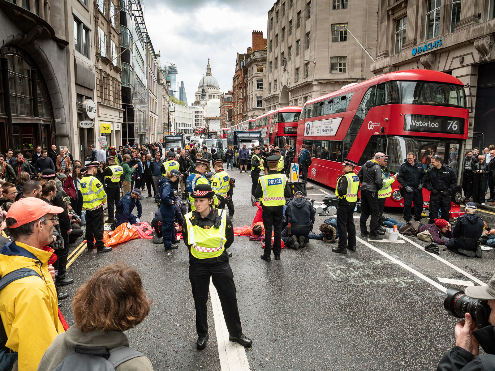 The view down Fleet St to St Paul's as Extinction Rebellion protestors lie across the road, glued to it.