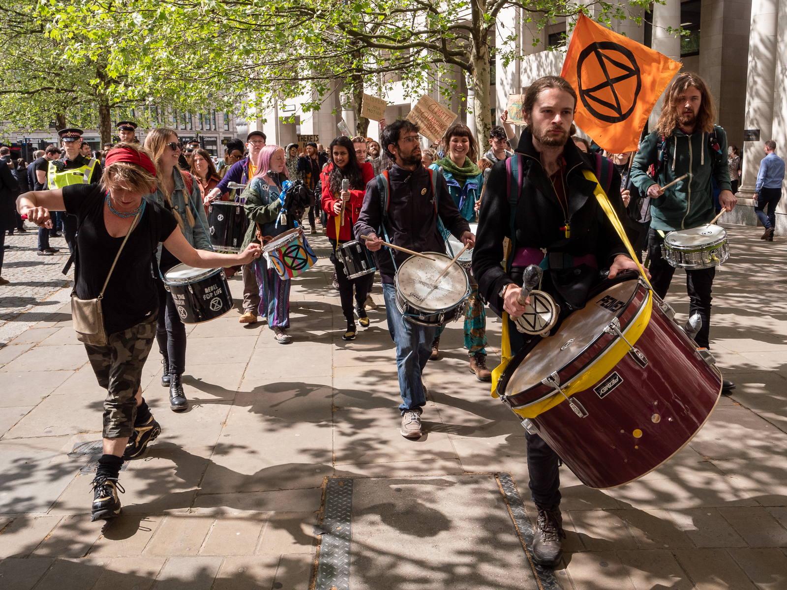 Extinction Rebellion drummers lead the way past St Paul's