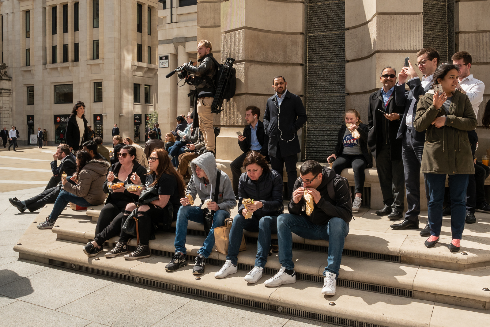 Paternoster Sq locals and tourists looking on
