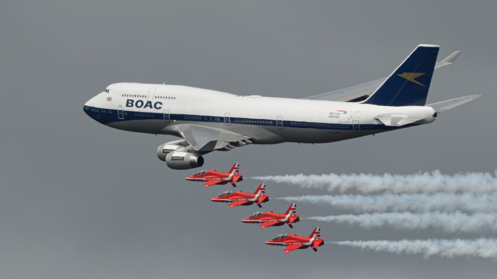100 years ago,    an ancestor company of British Airways made its first commercial flight. To celebrate this,    BA has painted up four of its aircraft in past colour schemes   . This 747 carries the markings of BOAC, and did a fly past with the Red Arrows (on a day when the heat haze was almost impenetrable).
