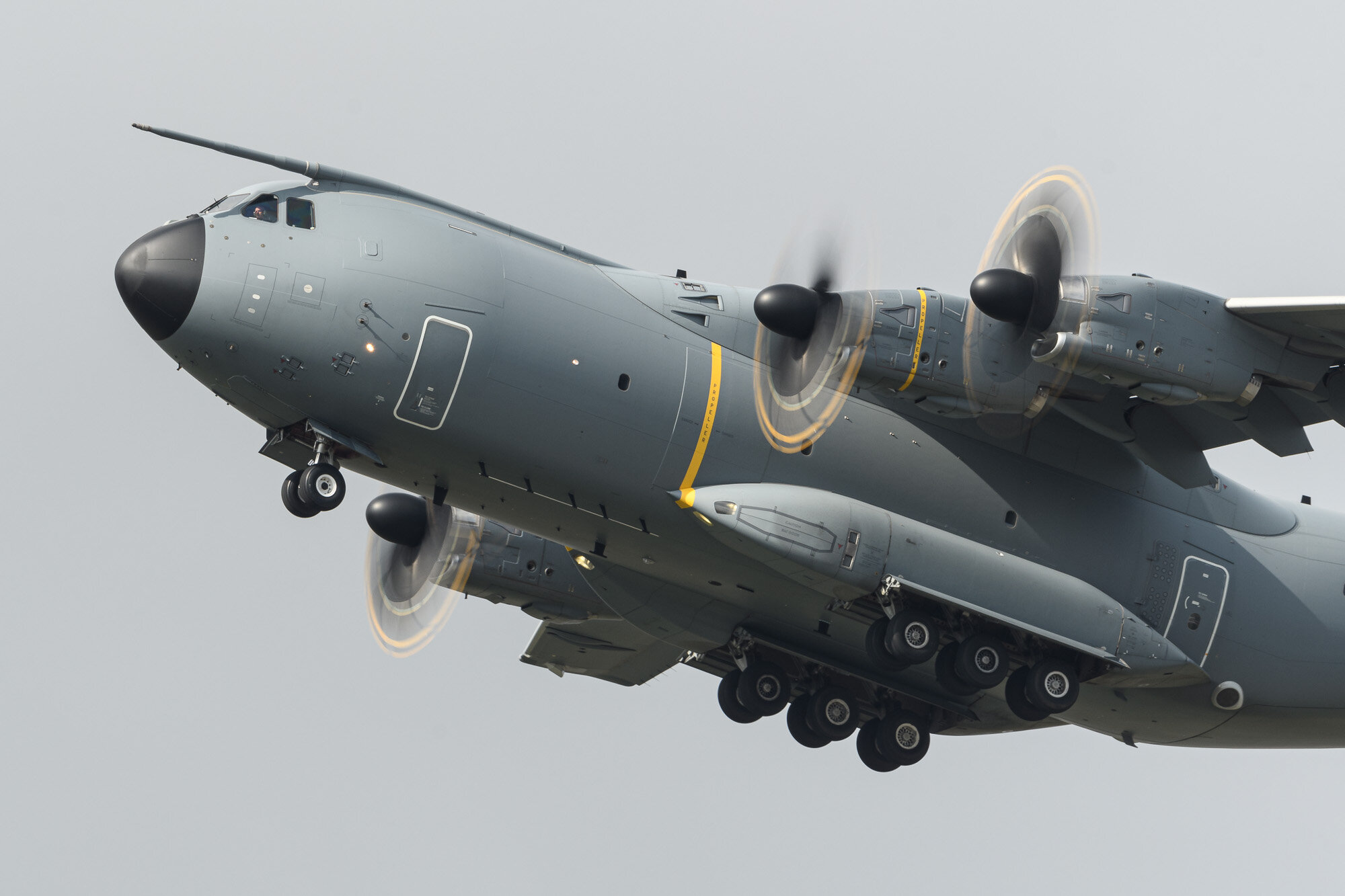 Airbus Military A400M taking off at Fairford. Nikon D500, 500PF, at f/13, 1/100 sec, ISO100. Shutter speed chosen to get full rotation of props.