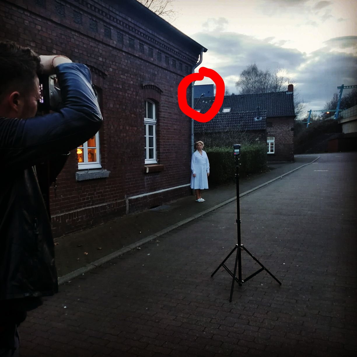 Balance the ambient, flash from front with as little shadow as possible, and a street lamp from above - easy right?