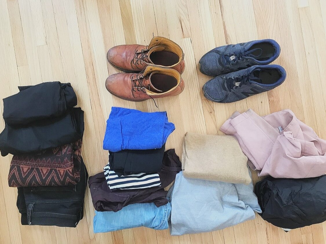 What I took to Ireland. Bottoms: Jeans, wool skirt, black pants, yoga pants. Tops: jean shirt, long sleeve merino wool crew neck, stripped shirt, black tank top, t-shirt. Top Layers: Long gray cardigan, carmel wool sweater, pink pleather jacket, rain jacket. Shoes: Boots, tennis shoes.