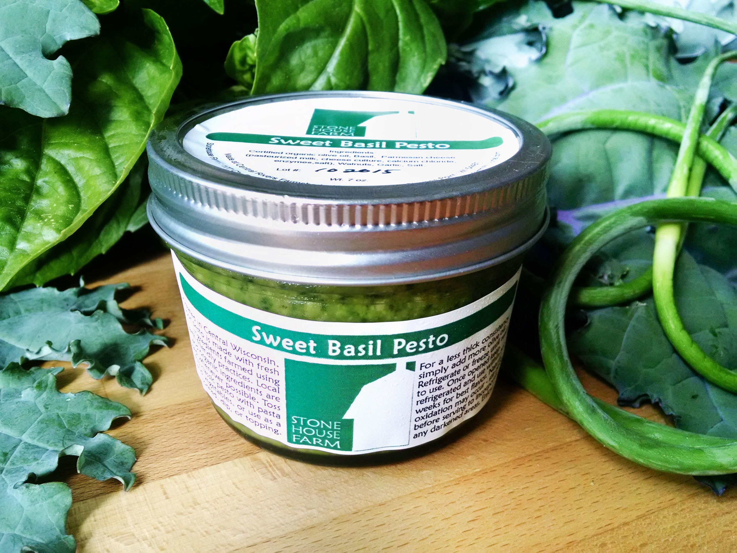 Sweet Basil Pesto:  Our trademark pesto! A (mostly) traditional blend of basil, certified organic olive oil, garlic, parmesan cheese, walnuts, and a pinch of sea salt. Enjoy this pesto with pasta, chicken, vegetables, on pizza, as a sandwich spread, or dip.