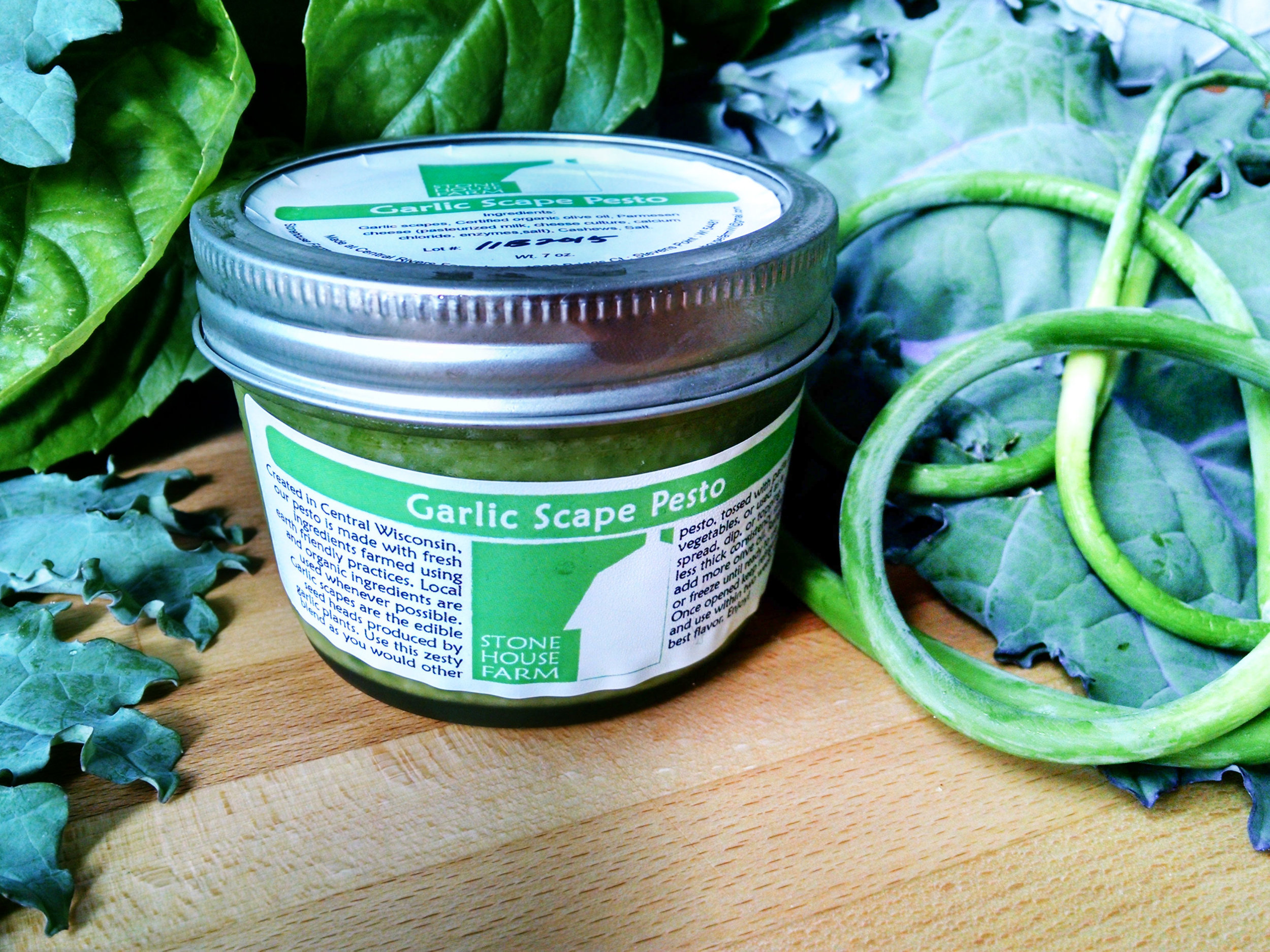 Garlic Scape Pesto:  This is a rich, spicy blend of garlic scapes, certified organic olive oil, parmesan cheese, cashews, and a pinch of sea salt. If you love garlic, this pesto is for you! It can be used in a variety of ways and is delicious blended with mayonnaise or greek yogurt.
