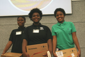 """Ajah and Naomi from the Carter School of Excellence proudly stand beside """"earit,"""" the winning design for the Chicago Maker's challenge!"""