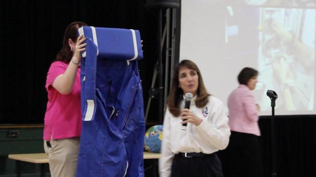 NASA astronaut Nancy Currie demonstrates how sleeping bags are used aboard the ISS (credit: Durham Public Schools)