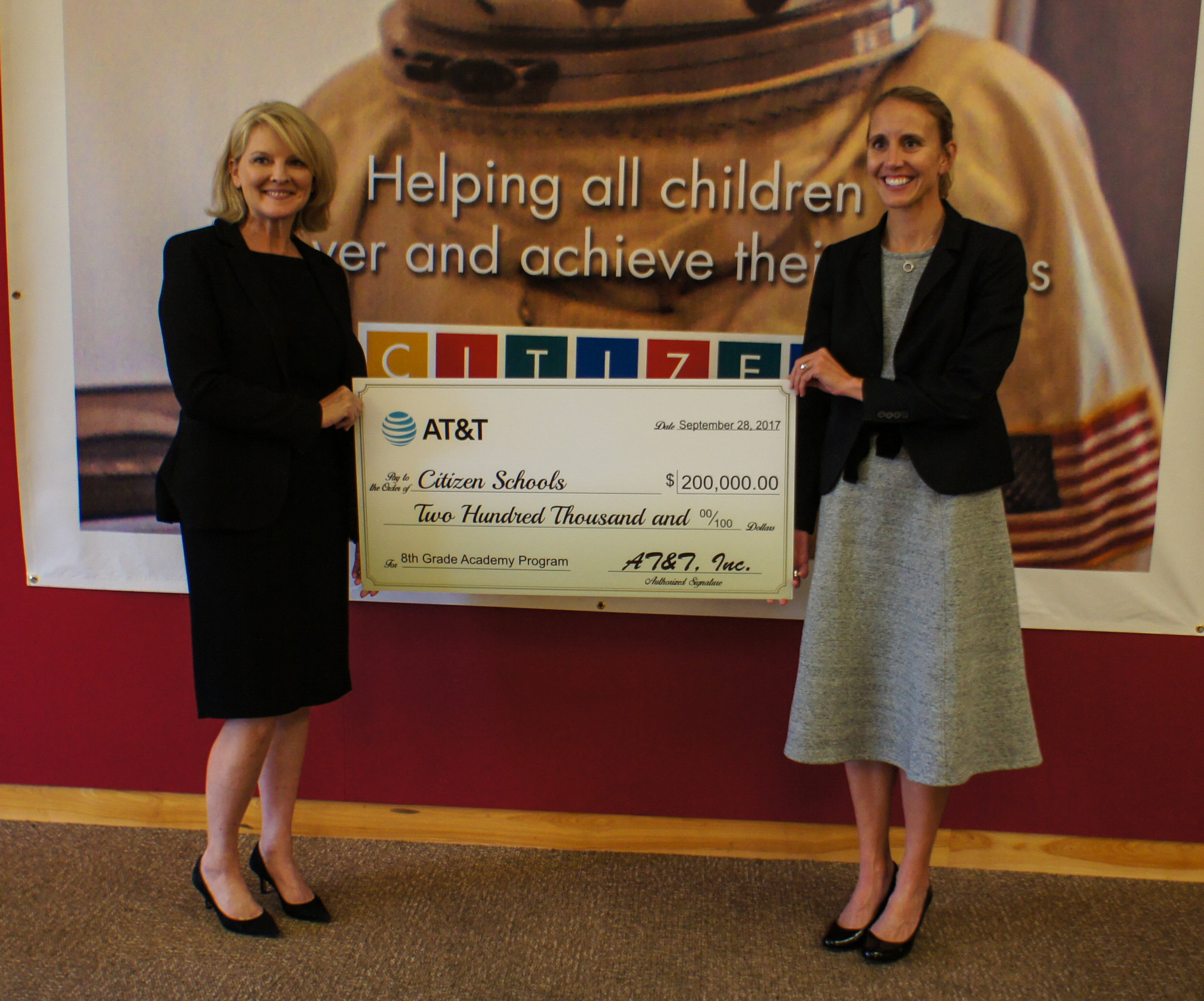 Patty Jacobs, President of AT&T New England, presents Citizen Schools CEO Em McCann with AT&T Aspire's $200,000 grant award