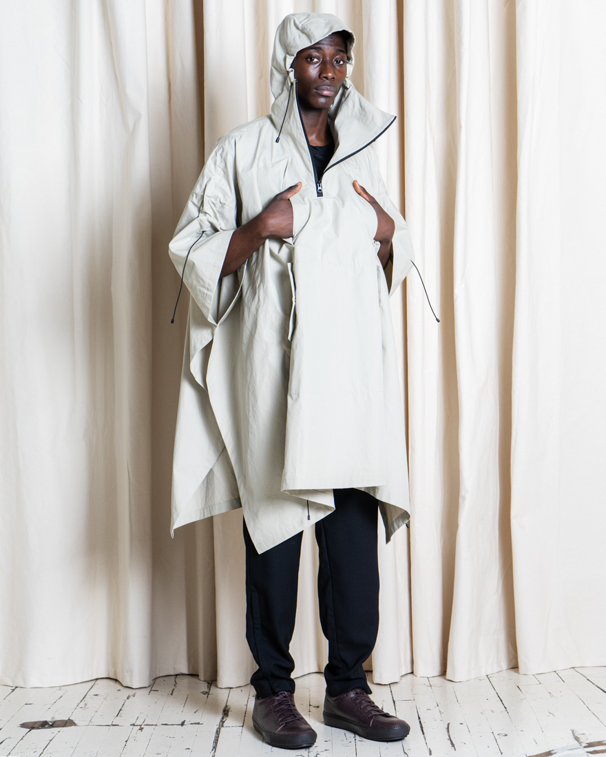 302-Outlier-SupermarineSunchannelPoncho-fit-angled-hoodup.jpg
