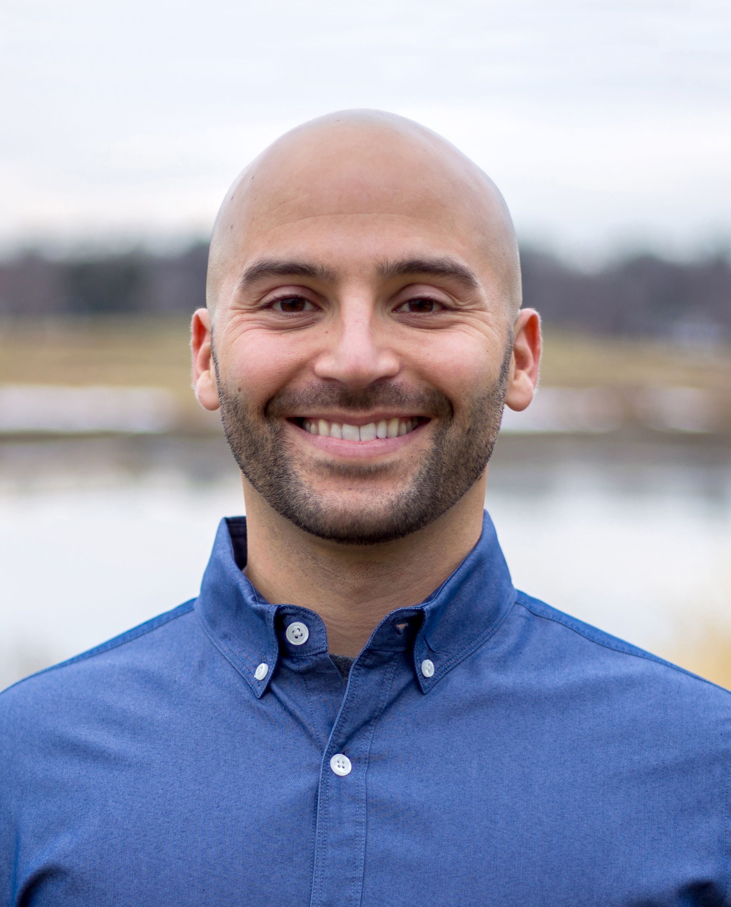 SamRega_Director_Headshot_300dpi_headroom.jpg