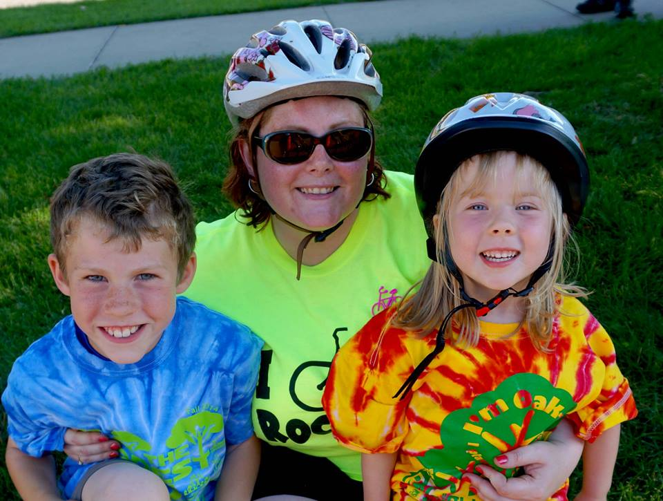 Jessica with her kids. Bike helmets, of course.