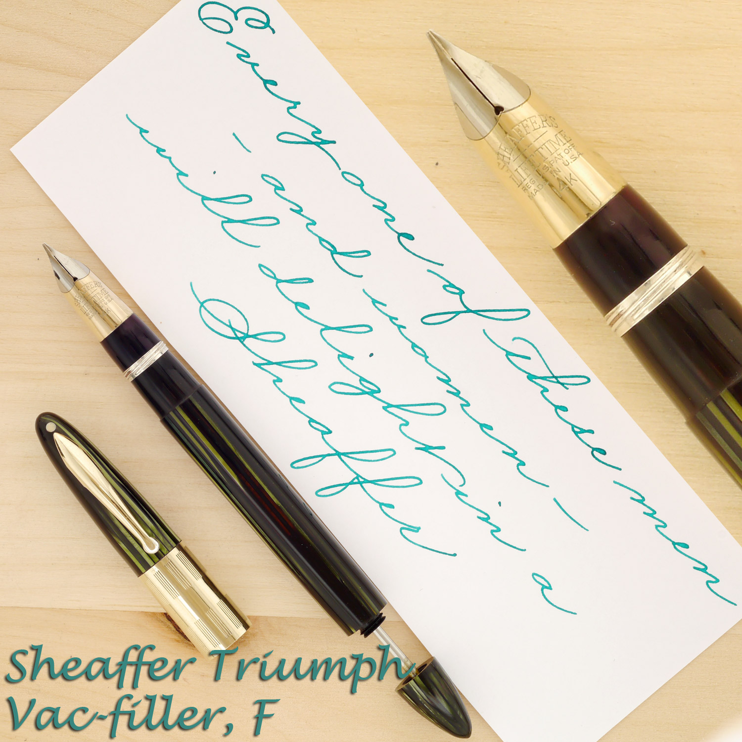 Sheaffer Triumph Vac 1250 in Marine Green, F, with the cap off and plunger rod partially extended