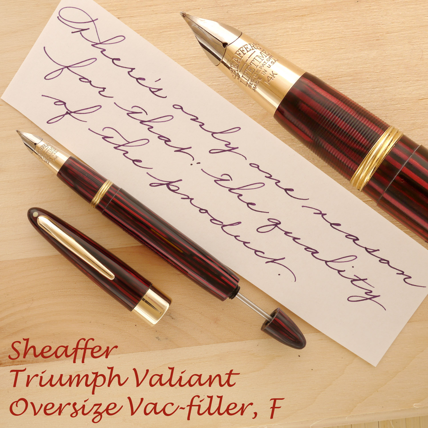 Sheaffer Triumph Valiant Vac Oversize Carmine, F, uncapped, with the plunger partially extended