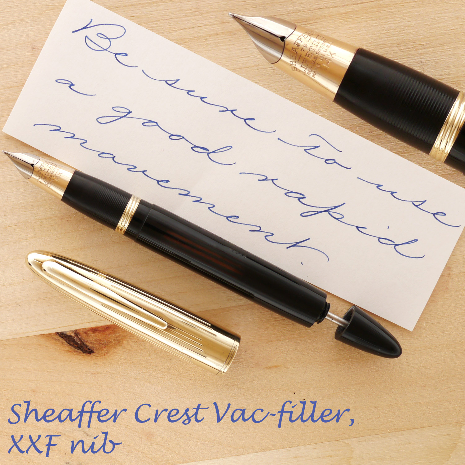 Sheaffer Crest Vac Black XXF, with the cap off and the plunger partially extended