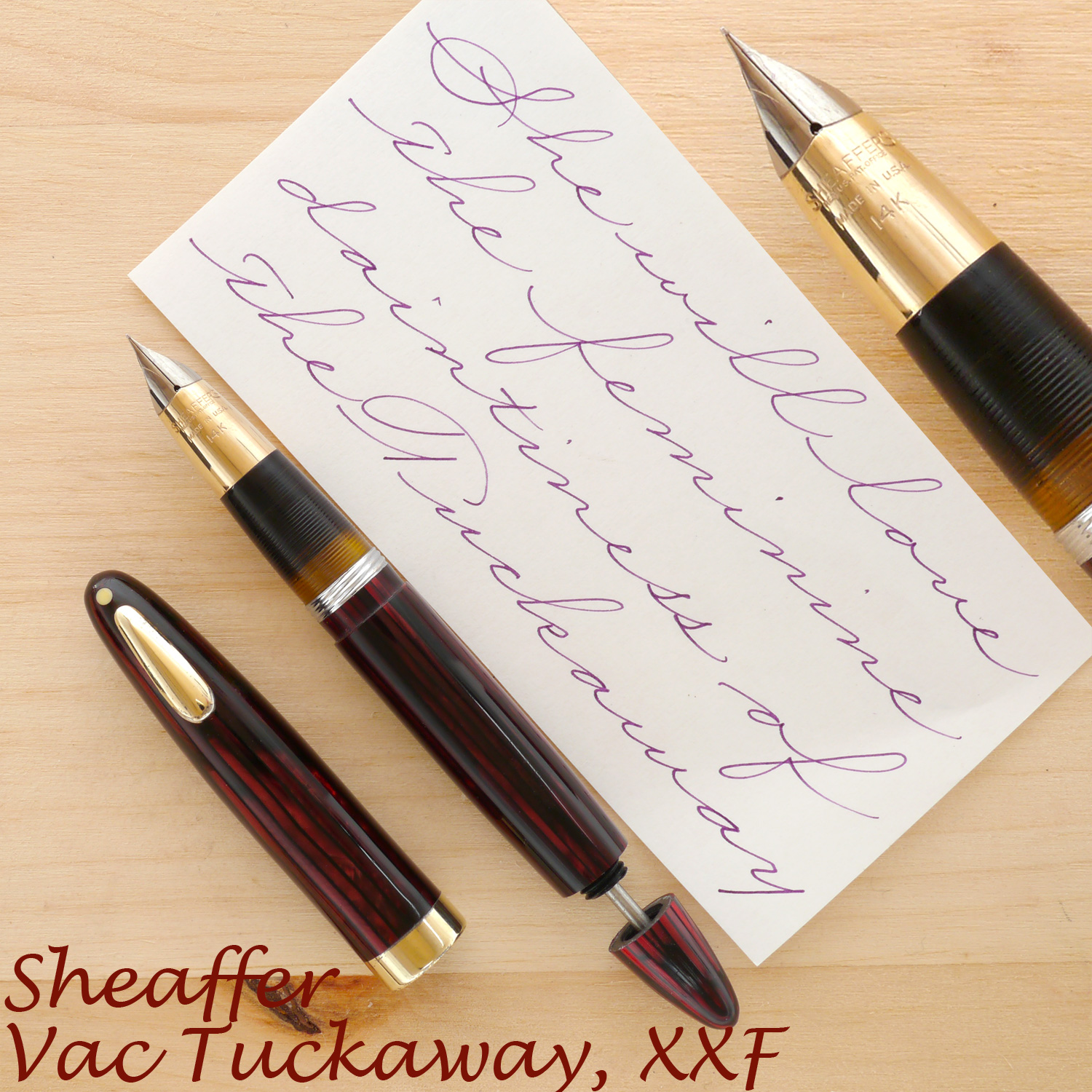 Sheaffer Tuckaway Vac in Carmine, XXF, uncapped, with the plunger rod partially extended