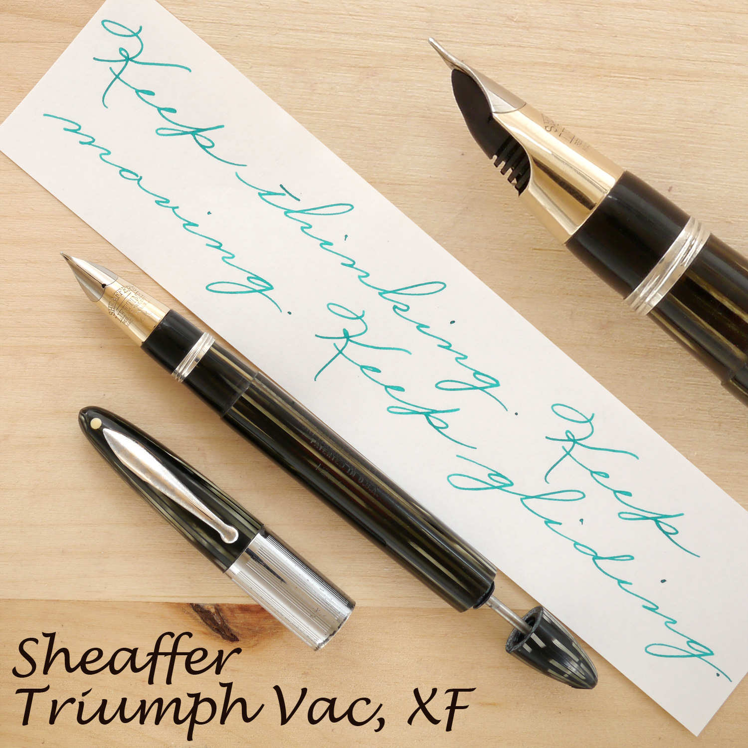 Sheaffer Triumph Vac, Gray Pearl, XF, uncapped, with the plunger rod partially extended