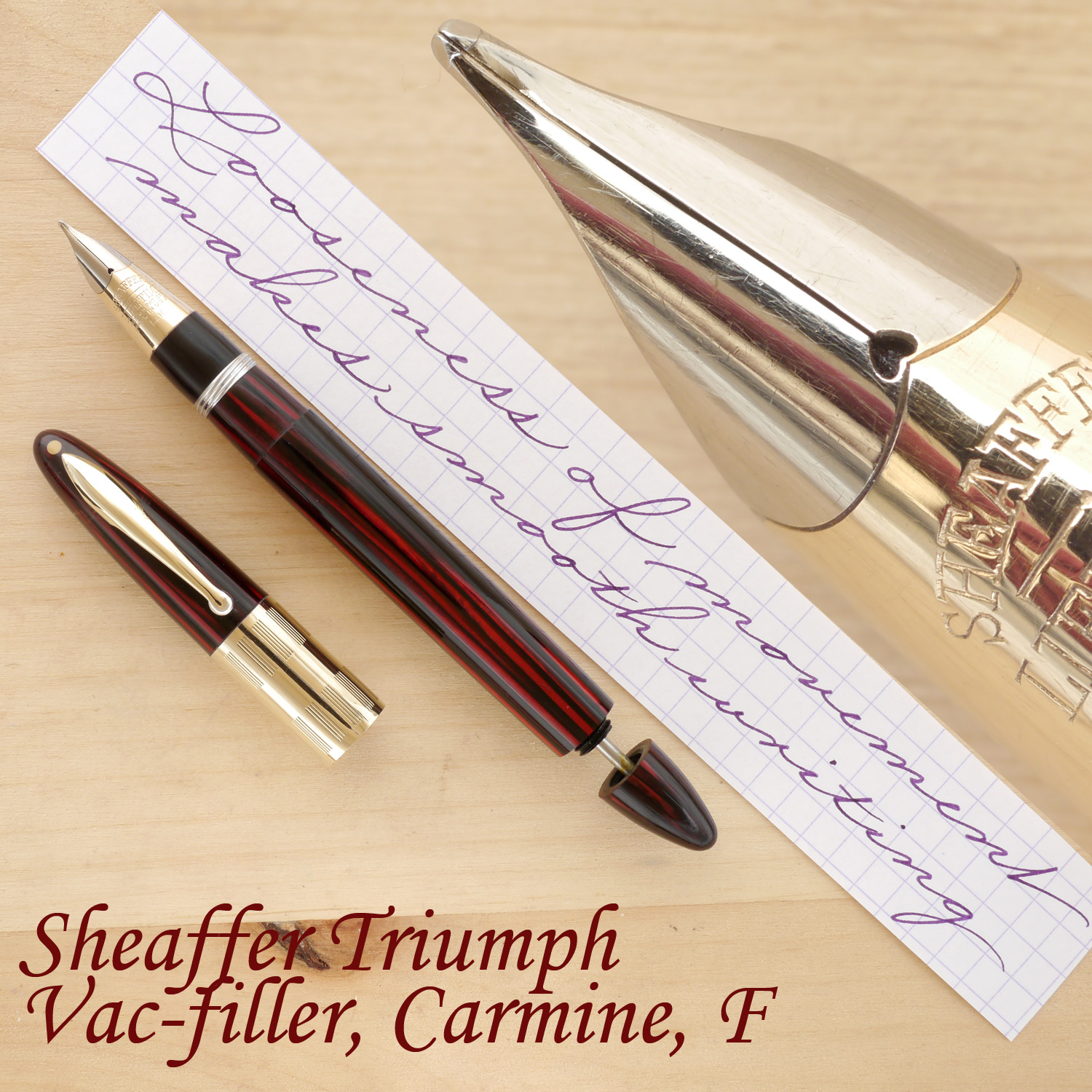 Sheaffer Triumph Fountain Pen, Carmine, F, uncapped, with the plunger partially extended