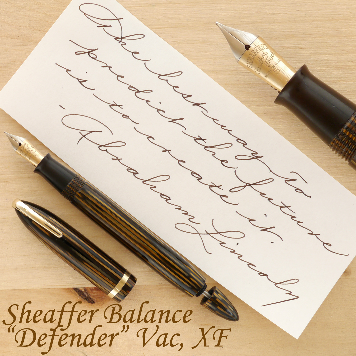 "Sheaffer Balance ""Defender"" Vac fountain pen, Golden Brown, XF, uncapped, with the plunger partially extended"