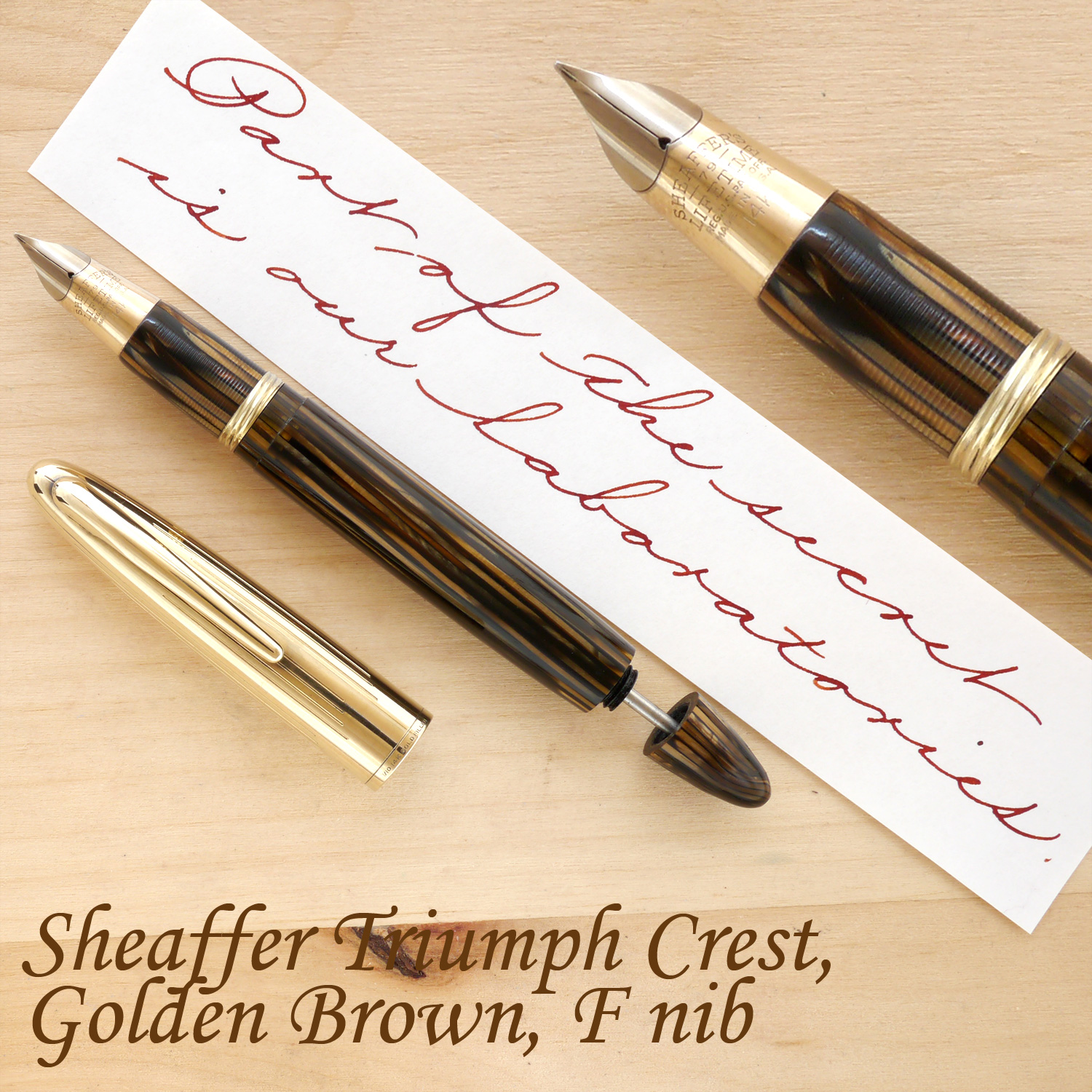 Sheaffer Triumph Crest Fountain Pen, Golden Brown, F, uncapped, with the plunger partially extended