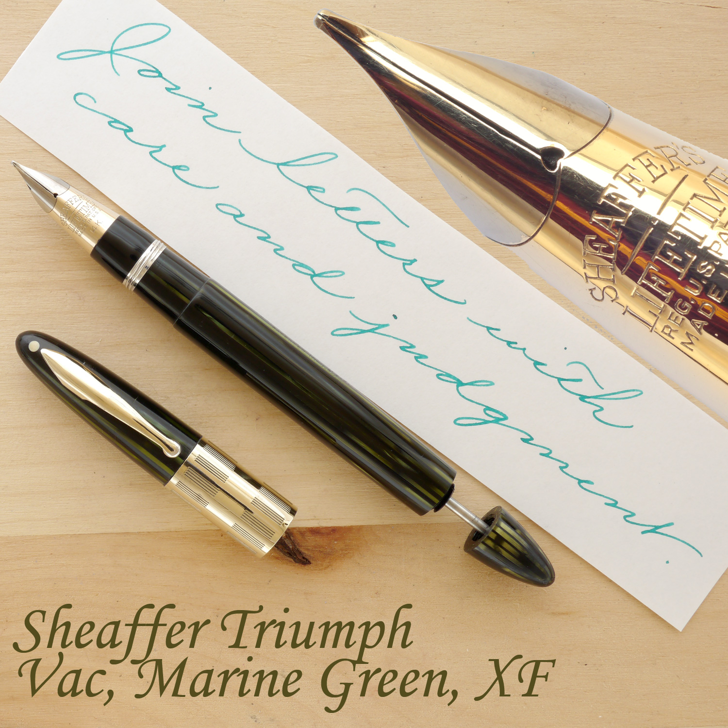 Sheaffer Triumph Vac Fountain Pen, Marine Green, XF, uncapped, with the plunger partially extended