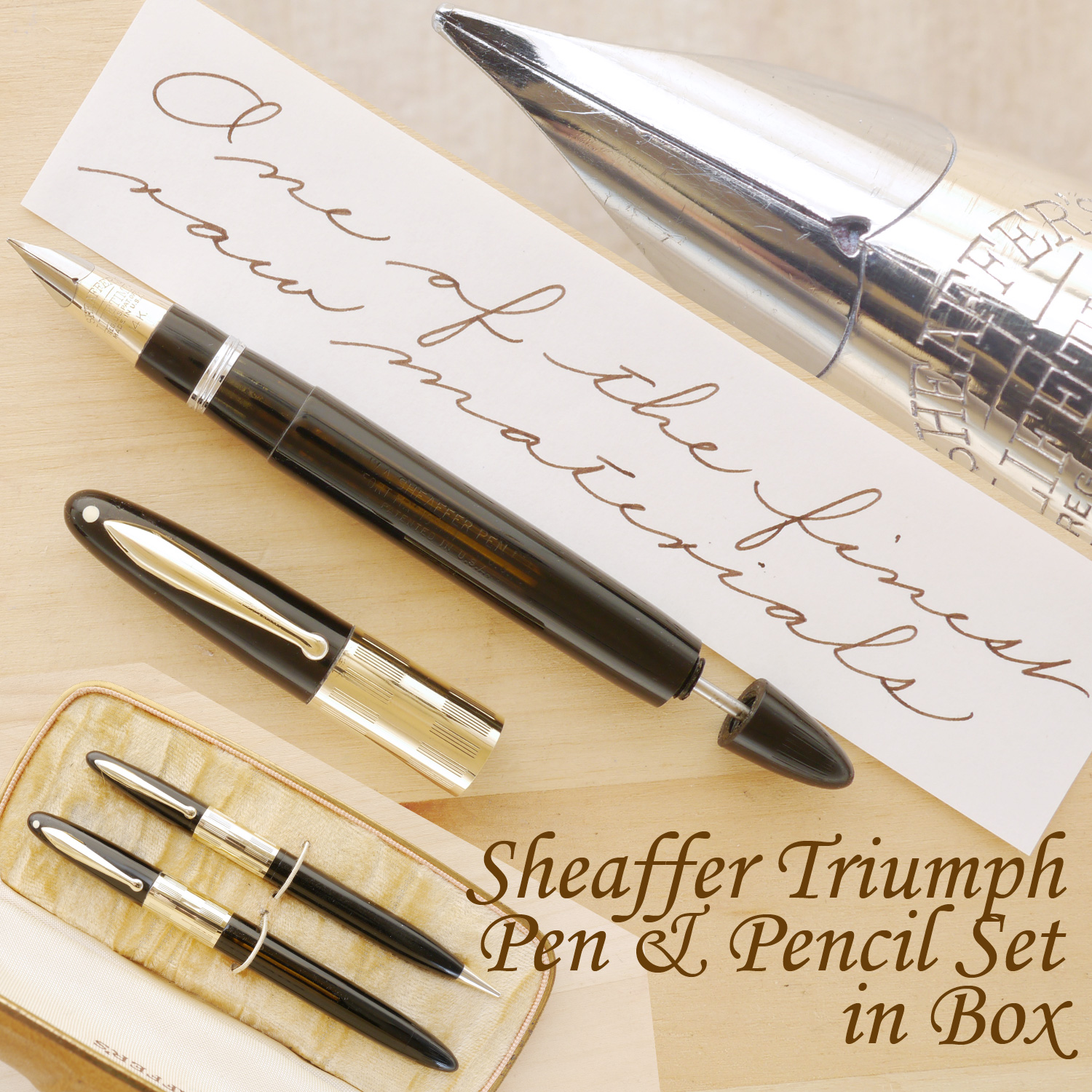 Sheaffer Triumph Vac Fountain Pen and Pencil Set, F, uncapped and with the plunger partially extended