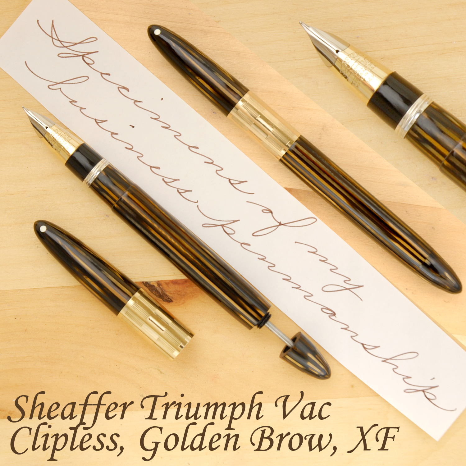 Sheaffer Triumph Vac Clipless, Golden Brown, XF, uncapped, with the plunger partially extended.