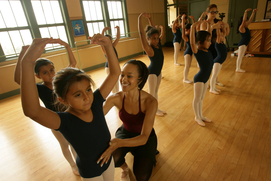 Ballet instructor Sue Murray works with students including Ariana Granillo, 8, during a ballet class at the Riverside Arts Academy at the Cesar Chavez Community Center in 2013. Riverside will receive an award for the program March 3.
