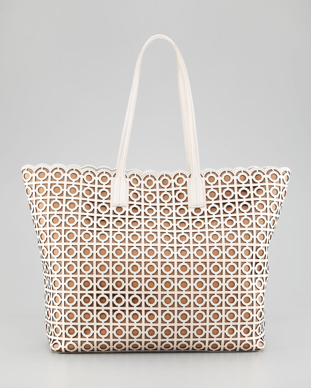 tory-burch-white-kelsey-lasercut-eastwest-tote-bag-product-1-6080679-938965542.jpeg