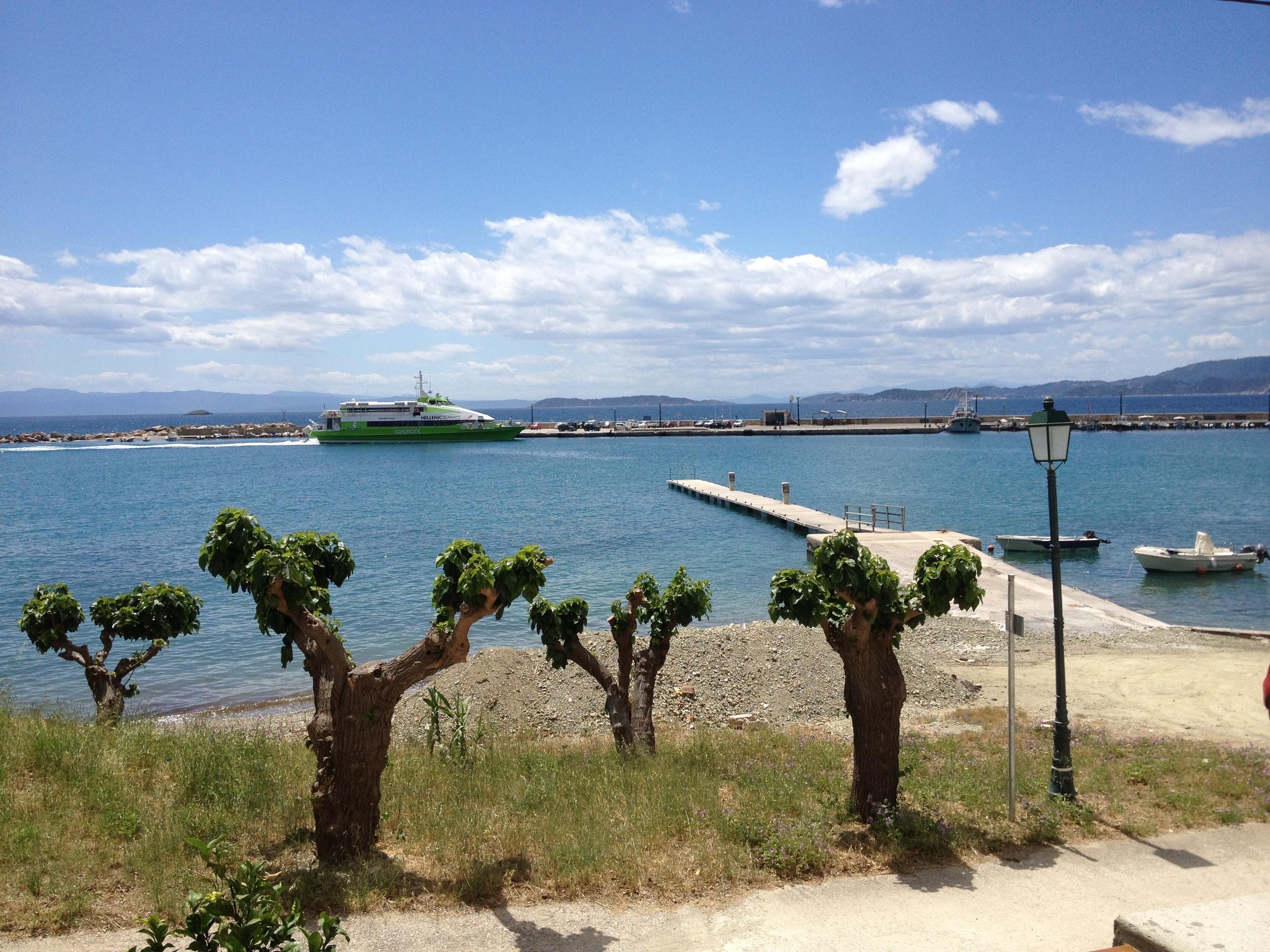 Catamaran Arrives - From Petrinos.JPG