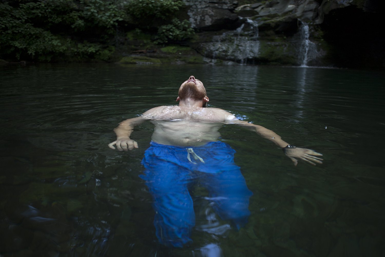 Rafal Rogoza enjoys a dip in a swimming hole at Plattekill Clove.